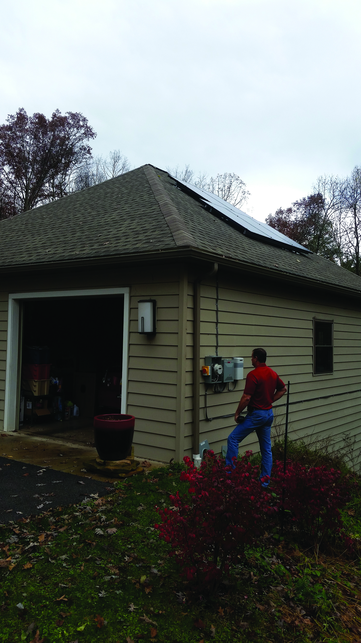 Valley REC Vice President of Operations Todd Ross inspects the metering for a solar interconnection at a residence in Juniata Township, Huntingdon County, in 2017.